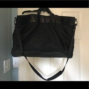 Black Tumi overnighter bag